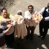 "Caritas leaders participating in a ""Food for All"" meeting in Rome this week raise up bread. Credit: Sheahen/Caritas"
