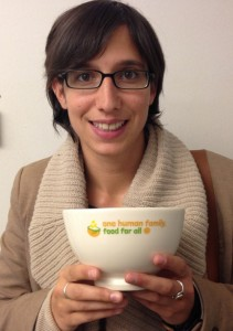 "MEP Elly Schlein holds a ""Food for All"" bowl to show her support."
