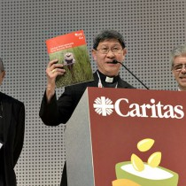 Cardinal Tagle holds up the Food Report